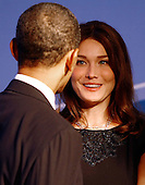Pittsburgh, PA - September 24, 2009 -- United States President Barack Obama (L) talks with French President Nicolas Sarkozy's wife Carla Bruni Sarkozy while welcoming her to the opening dinner  for G-20 leaders at the Phipps Conservatory on Thursday, September 24, 2009 in Pittsburgh, Pennsylvania. Heads of state from the world's leading economic powers arrived today for the two-day G-20 summit held at the David L. Lawrence Convention Center aimed at promoting economic growth.  .Credit: Win McNamee / Pool via CNP