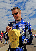 Nov. 13, 2009; Avondale, AZ, USA; NASCAR Sprint Cup Series driver Kurt Busch signs autographs during practice for the Checker O'Reilly Auto Parts 500 at Phoenix International Raceway. Mandatory Credit: Mark J. Rebilas-