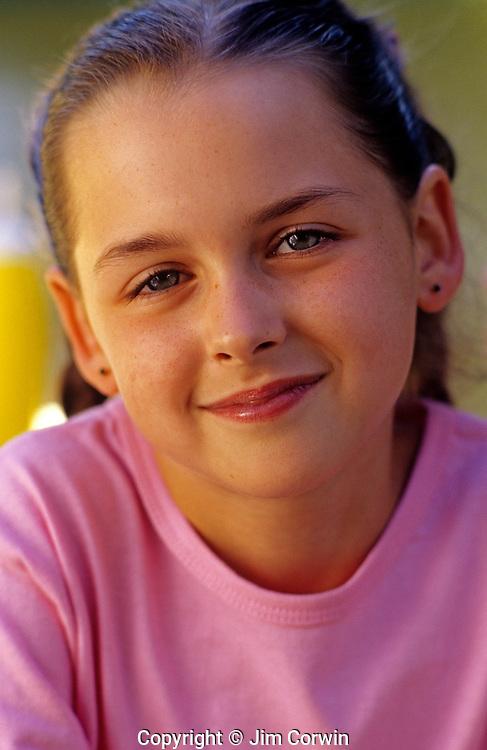 Young girl smiling at camera head and shoulder image Washington State