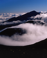 Clouds Engulfing Volcanic Cinder Cones, Haleakala National Park, Maui, Hawaii, USA.
