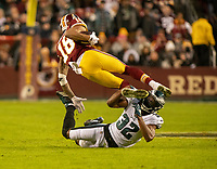 Washington Redskins wide receiver Josh Doctson (18) attempts to leap over Philadelphia Eagles cornerback Rasul Douglas (32) after making a catch in the first quarter at FedEx Field in Landover, Maryland on December 30, 2018.  The Eagles won the game 24 - 0. Photo Credit: Ron Sachs/CNP/AdMedia