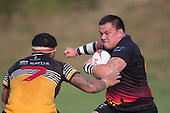 Robert Katu makes a determined run at Peter Vea. Counties Manukau Premier Club rugby game between Te Kauwhata and Onewhero, played at Te Kauwhata on Saturday April 16th 2016. Onewhero won the game 37 - 0 after leading 13 - 0 at Halftime. Photo by Richard Spranger.