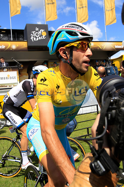 Race leader Yellow Jersey Vincenzo Nibali (ITA) Astana at sign on in Cambridge before the start of Stage 3 of the 2014 Tour de France running 155km from Cambridge to London. 7th July 2014.<br /> Picture: Eoin Clarke www.newsfile.ie