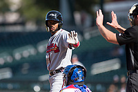 Peoria Javelinas right fielder Izzy Wilson (7), of the Atlanta Braves organization, asks home plate umpire Bryan Fields for time during an Arizona Fall League game against the Mesa Solar Sox at Sloan Park on October 24, 2018 in Mesa, Arizona. Mesa defeated Peoria 4-3. (Zachary Lucy/Four Seam Images)