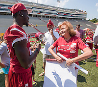 NWA Democrat-Gazette/J.T. WAMPLER Karen Worden of Rogers talks to University of Arkansas defensive back Davyon McKinney Sunday Aug. 16, 2015 during 2015 UA Fan Day at Donald W. Reynolds Razorback Stadium in Fayetteville. Several hundred fans attended the annual event to get close up to Razorback football players and coaches to get autographs and photographs.