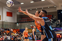 NZ Men's Cameron Powell goes one on one with All Stars Claire Kersten during the Cadbury Netball Series match between NZ Men and All Stars at the Bruce Pullman Arena in Papakura, New Zealand on Friday, 28 June 2019. Photo: Dave Lintott / lintottphoto.co.nz
