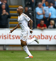 Andre Ayew of Swansea City celebrates scoring his goal to make the score 1-1 during the Barclays Premier League match between Swansea City and Manchester City played at The Liberty Stadium, Swansea on 15th May 2016