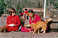 Wasco, Oregon, January 1984:  Two women disciples of Bhagwan Rajneesh, having a meal together outdoors in Rajneeshpuram. Rajneeshpuram, was an intentional community in Wasco County, Oregon, briefly incorporated as a city in the 1980s, which was populated with followers of the spiritual teacher Osho, then known as Bhagwan Shree Rajneesh. The community was developed by turning a ranch from an empty rural property into a city complete with typical urban infrastructure, with population of about 7000 followers.