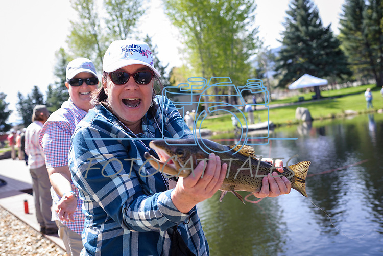 Lisa Selcer shows off the fish she caught with her River Buddy Gretchen Montgomery during the Casting for Recovery fishing clinic at Bently Ranch in Gardnerville, Nev. May 4, 2018.<br /> Photo by Candice Vivien/Nevada Momentum