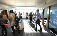 NWA Democrat-Gazette/ANDY SHUPE<br /> David Swain (right), owner representative for the Walton Arts Center, speaks Tuesday, Sept. 22, 2015, during a tour of the new administrative offices being constructed as part of Fayetteville&rsquo;s $12.3 million municipal parking deck project. The arts center contributed more than $2.2 million to the project which will house administrative staff and include additional back-of-house space for the performing arts center. Visit nwadg.com/photos to see more photographs from the tour.