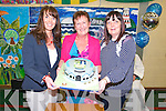 Mary Burke and Joe Nolan presents with a cake Principal Anne O'Sullivan of Castleisland Community College who retired  with over 30 years service at a celebration Mass at the school on Monday