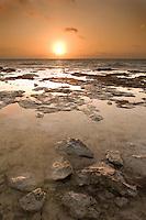 Tidepools at Sunrise at Bahia Honda, Florida Keys. Rocks are fossilized coral reef (limestone and calcium carbonate).