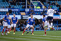 Adebayo Akinfenwa of Wycombe Wanderers heads towards goal during the FA Cup 1st round match between Portsmouth and Wycombe Wanderers at Fratton Park, Portsmouth, England on the 5th November 2016. Photo by Liam McAvoy.