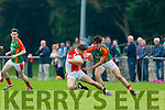 Fergal Hallissey Mid kerry tackles Cathal O Luing West Kerry  during their County Championship clash in Beaufort on Saturday