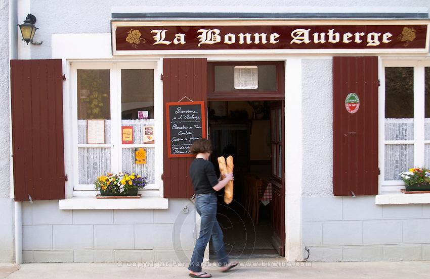 La Bonne Auberge restaurant. Woman with french baguette bread. Chavignol, Sancerre, Loire, France