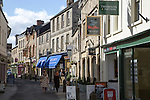 Narrow shopping street in town centre, Cirencester, Gloucestershire, England, UK,