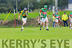 Kilmoyley's James McCarthy give chase as Crotta's Paudie Quille gets away  in the Garvey's Super Valu Senior County Hurling Championship Round 1 replay Kilmoyley V Crotta O'Neill's in Causeway on Sunday