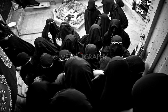 KHORRAMABAD, IRAN : A group of women after lighting candles on during the Ashura festival...Every year to mark the death of Imam Hussein, Shia Muslims mourn for two days. In Khorramabad and Lorestan in the west of Iran, during the first day of mourning, called Tasooa, women take a vow of silence and go through the streets with the children lighting candles. At 4 am on Ashura, the second day, men cover themselves in mud and then stand in front of a fire until the mud has dried to clay. After this they go to the mosque and pray...Photo by Farhad Babaei/Metrography