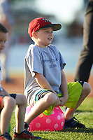 Kids participate in an on-field promotion during Batavia Muckdogs game against the Mahoning Valley Scrappers on June 23, 2015 at Dwyer Stadium in Batavia, New York.  Mahoning Valley defeated Batavia 11-2.  (Mike Janes/Four Seam Images)