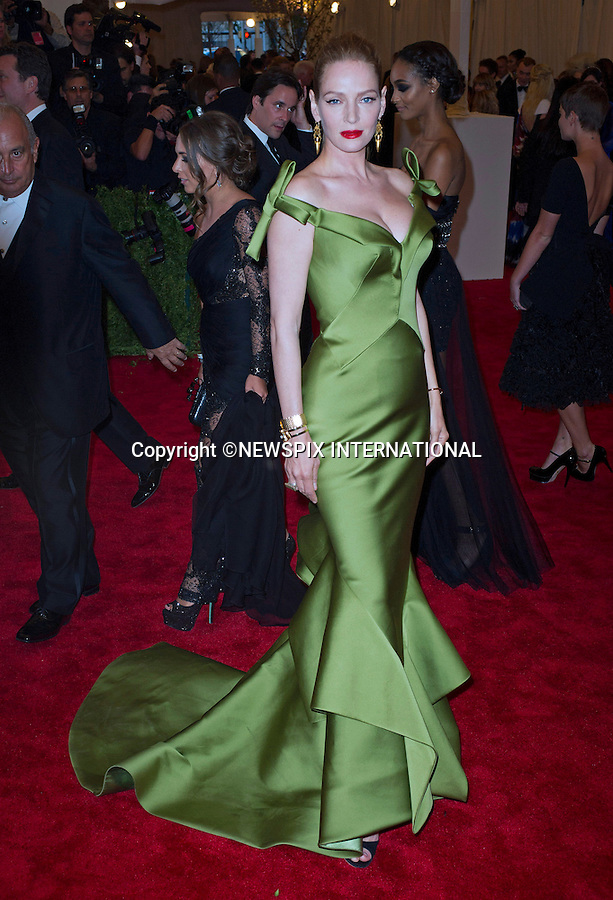 """UMA THURMAN.attends the Costume Institute Gala at the Metropolitan Museum of Art, New York.The event is considered the Oscars of the Fashion world_06/05/2013.Mandatory credit photo:©Dias/NEWSPIX INTERNATIONAL..**ALL FEES PAYABLE TO: """"NEWSPIX INTERNATIONAL""""**..PHOTO CREDIT MANDATORY!!: NEWSPIX INTERNATIONAL(Failure to credit will incur a surcharge of 100% of reproduction fees)..IMMEDIATE CONFIRMATION OF USAGE REQUIRED:.Newspix International, 31 Chinnery Hill, Bishop's Stortford, ENGLAND CM23 3PS.Tel:+441279 324672  ; Fax: +441279656877.Mobile:  0777568 1153.e-mail: info@newspixinternational.co.uk"""