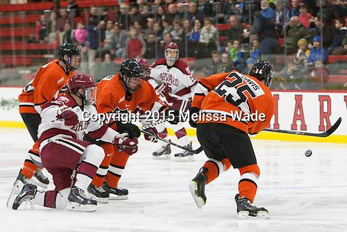 Sean Malone (Harvard - 17), Ben Foster (Princeton - 22), Tommy Davis (Princeton - 25) - The Harvard University Crimson defeated the visiting Princeton University Tigers 5-0 on Harvard's senior night on Saturday, February 28, 2015, at Bright-Landry Hockey Center in Boston, Massachusetts.
