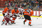Sean Malone (Harvard - 17), Ben Foster (Princeton - 22), Tommy Davis (Princeton - 25) - The Harvard University Crimson defeated the visiting Princeton University Tigers 5-0 on Harvard's senior night on Saturday, February 28, 2015, at Bright-Landry Hockey Center in Boston, Massachusetts.
