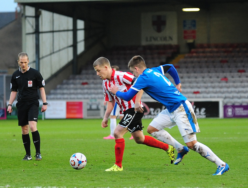 Lincoln City&rsquo;s Terry Hawkridge vies for possession with Dover Athletic's Sam Magri<br /> <br /> Photographer Andrew Vaughan/CameraSport<br /> <br /> Football - Vanarama National League - Lincoln City v Dover Athletic - Saturday 9th January 2016 - Sincil Bank - Lincoln<br /> <br /> &copy; CameraSport - 43 Linden Ave. Countesthorpe. Leicester. England. LE8 5PG - Tel: +44 (0) 116 277 4147 - admin@camerasport.com - www.camerasport.com