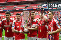 Ashley Fletcher of Barnsley, Adam Hammill ,Conor Hourihane with the trophy Sam Winnall and Josh Brownhill after winning the Johnstone's Paint Trophy Final match between Oxford United and Barnsley at Wembley Stadium, London, England on 3 April 2016. Photo by Alan  Stanford / PRiME Media Images.