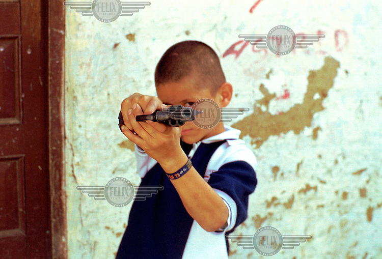 ©Paul Smith/Panos Pictures..COLOMBIA: MedellÌn..'La Chinga', a 13-year-old gang member who has killed five times, some of these hired killings.