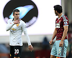 West Ham's Kames Tomkins accuses Manchester United's Robin Van Persie of an elbow<br /> <br /> Barclays Premier League- West Ham United vs Manchester United  - Upton Park - England - 8th February 2015 - Picture David Klein/Sportimage