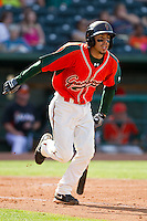 Alfredo Lopez (7) of the Greensboro Grasshoppers starts down the first base line against the Delmarva Shorebirds at NewBridge Bank Park on May 26, 2013 in Greensboro, North Carolina.  The Grasshoppers defeated the Shorebirds 11-2.  (Brian Westerholt/Four Seam Images)