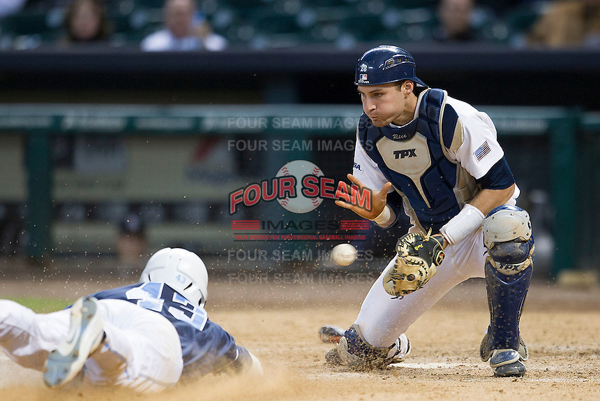 Rice Owls catcher Geoff Perrot #28 catches a throw as Korey Dunbar #43 slides towards the plate in the eighth inning of the NCAA baseball game against the North Carolina Tar Heels on March 1st, 2013 at Minute Maid Park in Houston, Texas. North Carolina defeated Rice 2-1. (Andrew Woolley/Four Seam Images).