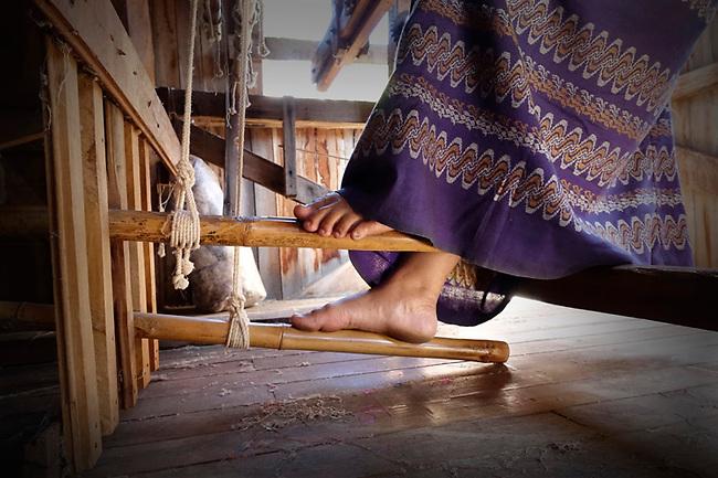 Feet of textile worker, Inle Lake, Burma