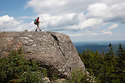 Caribou - Speckled Mountain Wilderness - A hiker explores the exposed summit of Caribou Mountain in the White Mountain National Forest of Maine.