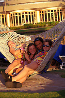 Girls in hammock at a resort on the Big Island.