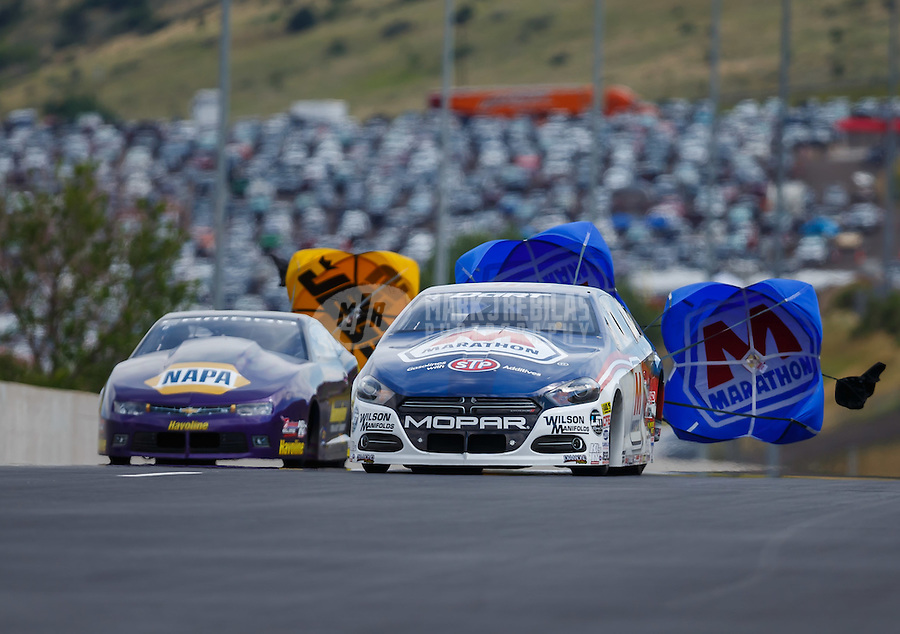 Jul 24, 2016; Morrison, CO, USA; NHRA pro stock driver Allen Johnson (right) defeats Vincent Nobile to win the Mile High Nationals at Bandimere Speedway. Mandatory Credit: Mark J. Rebilas-USA TODAY Sports