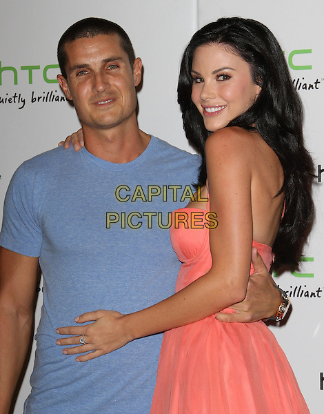 guest & Jayde Nicole.The HTC Statusª Social Launch Event held at Paramount Studios in Hollywood, California, USA..July 19th, 2011.half length pink coral strapless dress side blue t-shirt.CAP/ADM/KB.©Kevan Brooks/AdMedia/Capital Pictures.