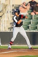 Ronald Guzman (22) of the Hickory Crawdads at bat against the Kannapolis Intimidators at CMC-Northeast Stadium on May 5, 2014 in Kannapolis, North Carolina.  The Intimidators defeated the Crawdads 5-2.  (Brian Westerholt/Four Seam Images)