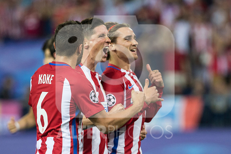Antoine Griezmann, Fernando Torres and Koke Resurrecccion  of Atletico de Madrid celebrates after scoring a goal  during the match of  Champions LEague between  Atletico de Madrid and LEicester City Football Club at Vicente Calderon  Stadium  in Madrid, Spain. April 12, 2017. (ALTERPHOTOS / Rodrigo Jimenez)