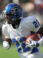Armwood Hawks defensive back Leon McQuay #22 runs upfield for a 32 yard touchdown after intercepting a pass during the first quarter of the Florida High School Athletic Association 6A Championship Game at Florida's Citrus Bowl on December 17, 2011 in Orlando, Florida.  The score at halftime is Armwood 16 - Miami Central 14.  (Mike Janes/Four Seam Images)