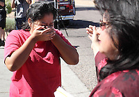 Phoenix, Arizona, USA-- Josefina Almanzar reacts as Maricopa County Sheriff deputies arrest her husband during a raid on a Phoenix, Arizona, business.  Deputies arrested 24 people who were thought to be using false ID to get employment. (Pat Shannahan/ The Arizona Republic)