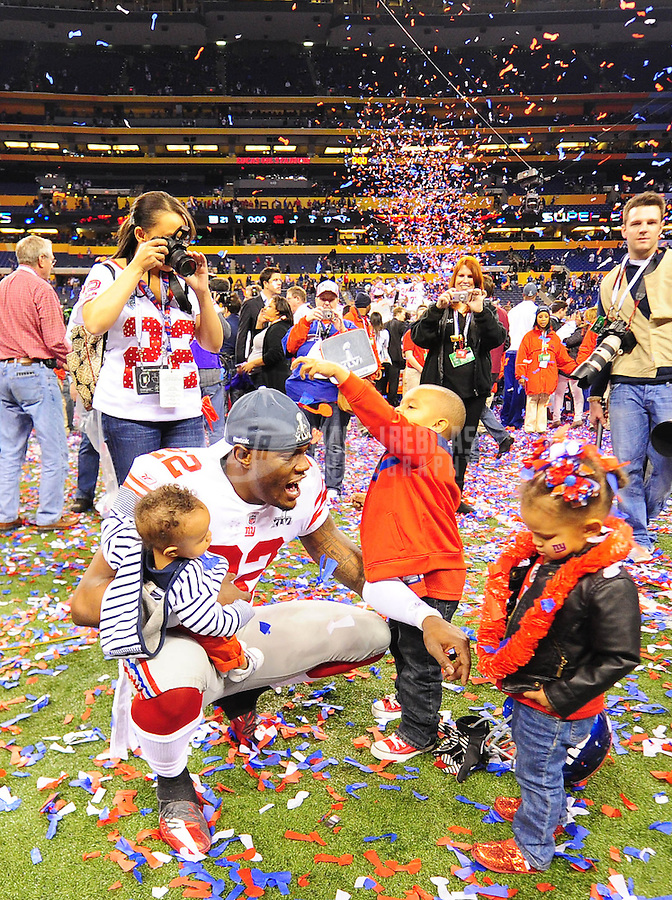 Feb 5, 2012; Indianapolis, IN, USA; New York Giants defensive back Derrick Martin (22) celebrates with family after the Giants defeated the New England Patriots 21-17 in Super Bowl XLVI at Lucas Oil Stadium.  Mandatory Credit: Mark J. Rebilas-