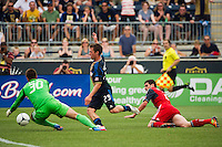 Toronto FC goalkeeper Milos Kocic (30) comes out to stop Antoine Hoppenot (29) of the Philadelphia Union. The Philadelphia Union defeated Toronto FC 3-0 during a Major League Soccer (MLS) match at PPL Park in Chester, PA, on July 8, 2012.