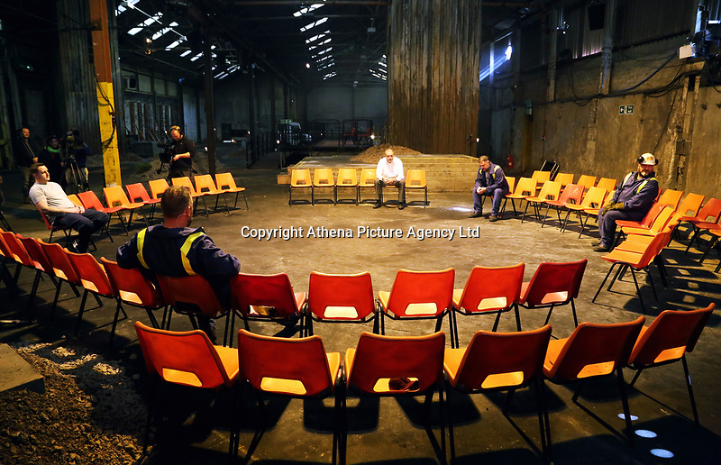 """Pictured: The four main characters rehearsing<br /> Re: Press rehearsal of """"We'Re Still Here"""", a play created by Rachel Trezise, Common Wealth and the National Theatre Wales about steelworkers, which will be performed in Byass Works, a disused industrial unit, in Port Talbot, south Wales, UK."""
