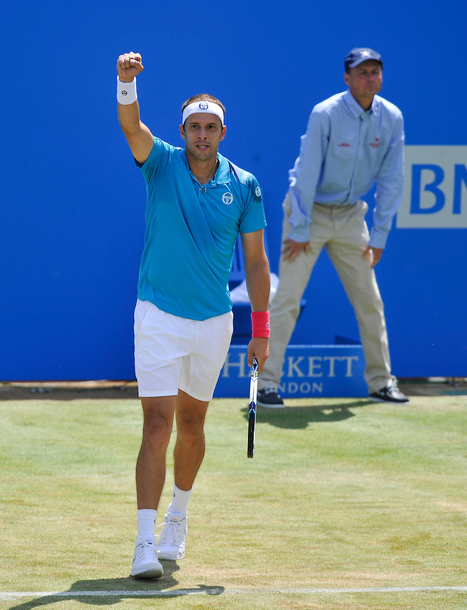 Gilles Muller (LUX) in action today during his victory over  Grigor Dimitrov (BUL) in their Men&rsquo;s Singles Second Round match - Gilles Muller (LUX) def Grigor Dimitrov (BUL) 6-4, 7-6<br /> <br /> <br /> Photographer Ashley Western/CameraSport<br /> <br /> Tennis - ATP 500 World Tour - AEGON Championships- Day 4 - Thursday 18th June 2015 - Queen's Club - London <br /> <br /> &copy; CameraSport - 43 Linden Ave. Countesthorpe. Leicester. England. LE8 5PG - Tel: +44 (0) 116 277 4147 - admin@camerasport.com - www.camerasport.com