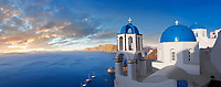 Panoramic sunset over the traditional Greek Orthodox churches of Oia (ia), Cyclades Island of  Thira, Santorini, Greece.<br /> <br /> The settlement of Oia had been mentioned in various travel reports before the beginning of Venetian rule, when Marco Sanudo founded the Duchy of Naxos in 1207 and feudal rule was instituted on Santorini. n 1537, Hayreddin Barbarossa conquered the Aegean islands and placed them under Sultan Selim II. However, Santorini remained under the Crispo family until 1566, passing then to Joseph Nasi and after his death in 1579 to the Ottoman Empire.