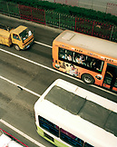 CHINA, Shanghai, buses drive down a city street