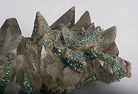 Cluster of intergrown, lustrous grayish-brown calcite crystals with granular overgrowths of finely crystallized iridescent pyrite of multiple colors. Brushy Creek Mine, Missouri, USA