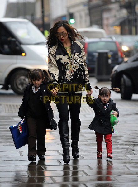 Myleene Klass with daughters Ava & Hero.spotted in Highgate, London, England..February 27th, 2013.full length mother mom mum kids children family sunglasses shades black jacket gold embroidered floral print leggings boots holding hands.CAP/AOU.©AOU/Capital Pictures.