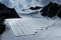 "Brunnenkogel Ferner--(Austrian word for glacier )is being wrapped with a fleece-like cover to keep it from melting.  Workers unwrapped rolls of the material and attached it to the top of the part of the glacier.  The parts covered melt slower than if not covered. The ski area at 3,400 meters is covered by the thirteen workers to help save the ski industry since the glacier is retreating.  The cost of materials is one Euro per square meter...The Alpine glaciers -- in Austria, Switzerland, France and Italy -- are losing one percent of their mass every year and, even supposing no acceleration in that rate, will have all but disappeared by the end of the century...More hot, dry summers like that of 2003 in Europe, when the loss speeded to five percent, could cut the life expectancy to no more than 50 years, according to Wilfried Haeberli of the University of Zurich...""We estimate that by the end of the 21st century, with a medium-type climate scenario, about five percent of what existed in the 1970s will have survived, he added."